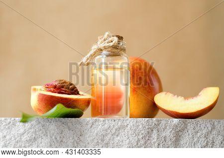 Natural Cosmetics, Hair Care. Natural Peach Oil. Bottle With Essential Peach Oil And Fresh Peaches O