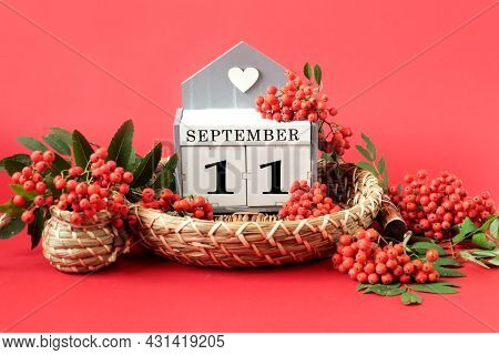Calendar For September 11 : The Name Of The Month In English, Cubes With The Number 11 On A Decorati