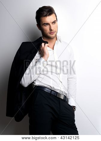 Fashion Young Man In White Shirt Holds The Black Jacket