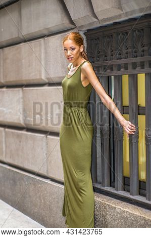 Woman Waiting Outside. Dressing In A Green, Long Maxi Tank Dress,  Stretching Arm, A Young Black Gir