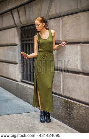 Woman Texting On Street. Dressing In A Green, Long Maxi Tank Dress, Dress Sandals, A Young Black Lad