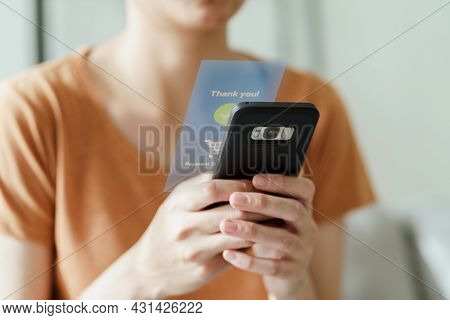 Young Woman Using Smart Phone For Online Shopping, Internet Banking, E-commerce, Spending Money, Wor