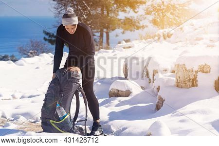 A Young Man In Merino Wool Thermal Underwear Comfortably Climbs The Mountains In Winter. Traveler Pu