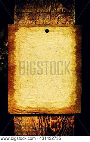 Old Blank Paper Hanging On The Weathered Wooden Background Closeup