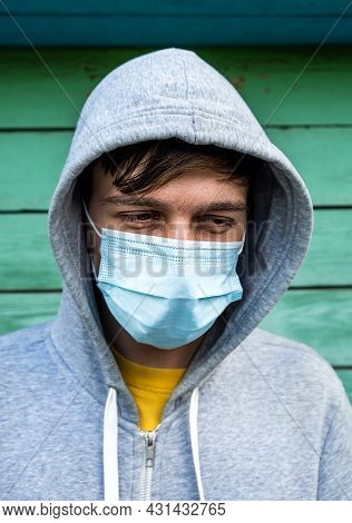 Sad Young Man In The Flu Mask On The Old Wall Background Outdoor