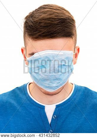 Young Man With A Flu Mask On A Face On The White Closeup