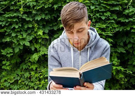 Young Man With A Books In The Summer Park