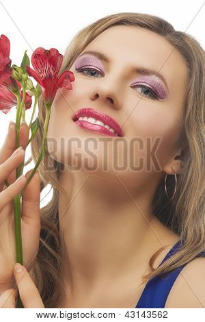 Blond Woman With Bunch Of Flowers