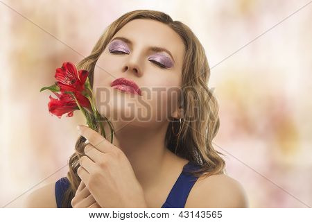 Portrait Of Young Blond Woman With Flowers