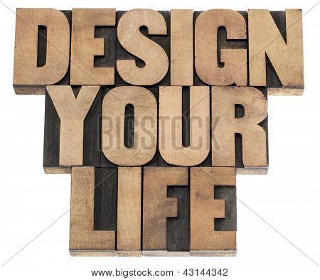 design your life - self development concept - isolated text in letterpress wood type printing blocks