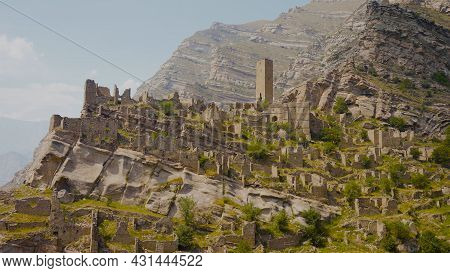 Ruins Of Ancient City On Rocks On Sunny Day. Action. Stone City On Rock In Mountains. Historical Sto