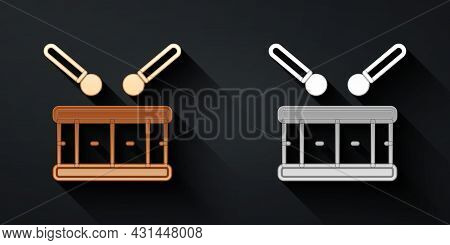 Gold And Silver Drum With Drum Sticks Icon Isolated On Black Background. Music Sign. Musical Instrum