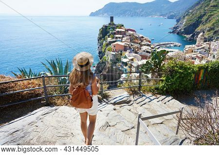 Tourism In Italy. Young Female Backpacker Going Downstairs In The Cinque Terre National Park. Beauti