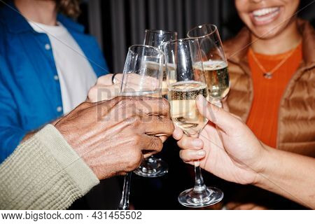 Close Up Of Young People Clinking Champagne Glasses At Party, Shot With Flash, Copy Space