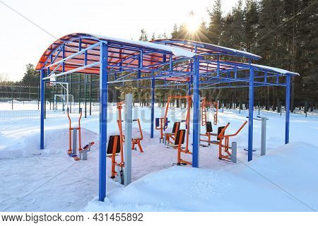 Sports Simulators Under Light Roof, Outdoor In Winter, Park Sports Area Near Forest Border, Without