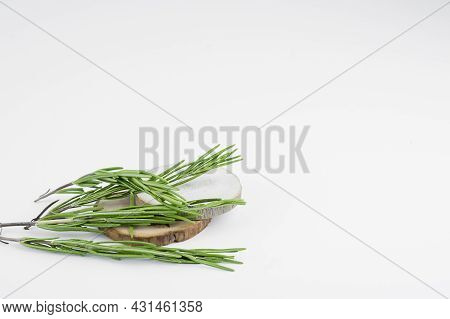 Sprig Of Tarragon On A Wooden Substrate Against A Light Background, Copy Space, Selective Focus