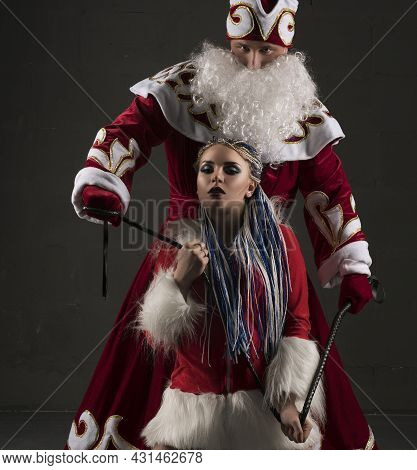 Young Sexy Snow Maiden With Her Santa Clause View
