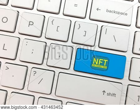 Computer Keyboard Enter Button With Nft Symbol. Non Fungible Tokens Concept