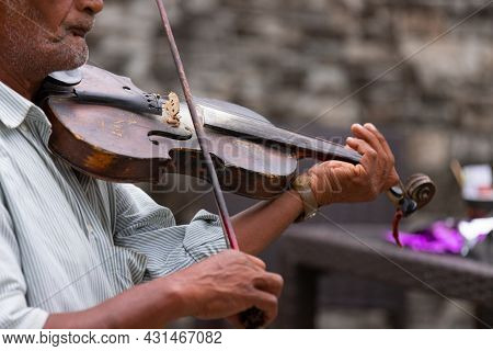 Great Musician In The Past, Now An Old Man Using Violin Is Performing A Wonderful Lyrical Melody For