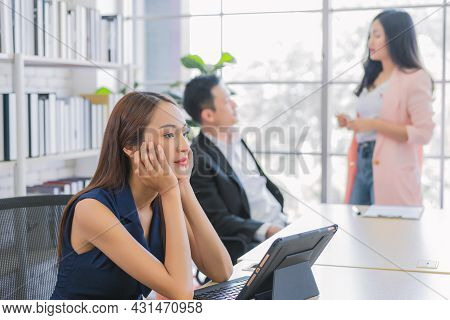 Bored Businesswoman On Workplace During Work Meeting At Modern Office, Concept Of Exhausted Business