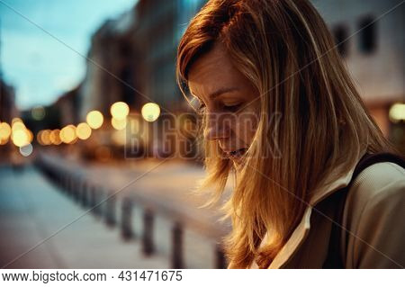 Portrait Of Woman At Night City Street With Bokeh Lights