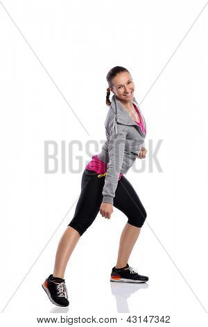 Young smiling woman doing fitness dance