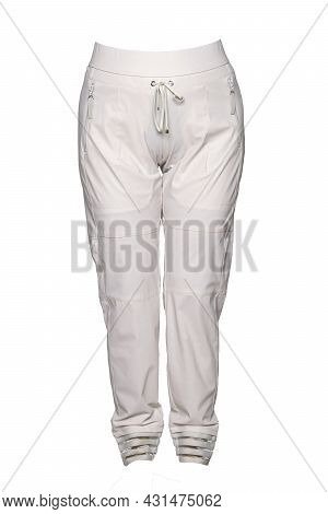 Woman Casual Trousers. Elegant Sporty Female Beige Trousers On Mannequin Isolated On White Backgroun