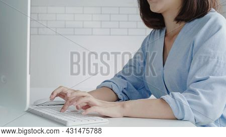 Beautiful Young Smiling Asian Woman Working On Laptop While At Home In Office Work Space. Businesswo