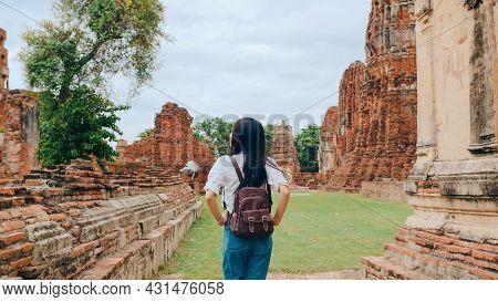 Traveler Asian Woman Spending Holiday Trip At Ayutthaya, Thailand, Japanese Backpacker Female Enjoy