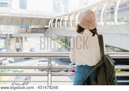 Traveler Backpacker Asian Woman Travel In Bangkok, Thailand. Happy Young Female Spending Holiday Tri