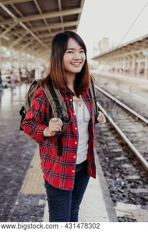 Young Asian Woman Backpacker Traveler Walking Alone At Train Station Platform With Backpack. Asian W