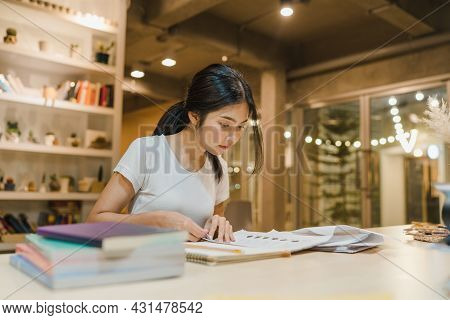 Asian Student Women Reading Books In Library At University. Young Undergraduate Girl Do Homework, Re