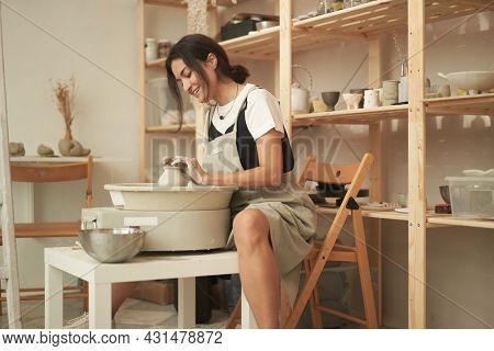 Woman crafting handmade crockery in workshop