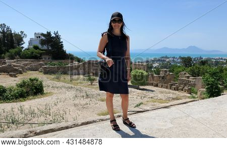 Young Woman Photographer On The Background Of The Ravines Of Carthage In Tunisia