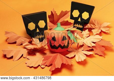 Volumetric Paper Skulls And Jack-o-lantern With Autumn Leaves. Real Volumetric Handmade Paper Object