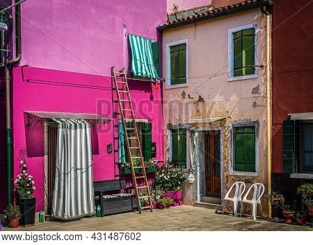 Colorfull painted front houses and Front yard at Brurano Island, Venice, Italy
