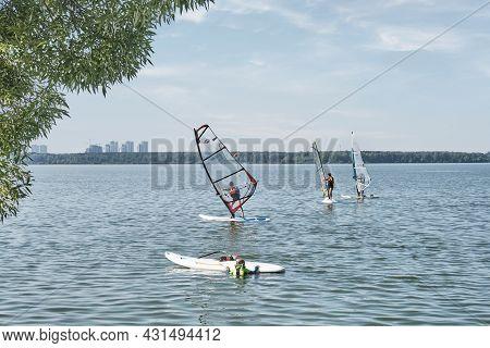 Yekaterinburg, Russia - August 19. 2021: Windsurfing Training At Childrens School. Several Children