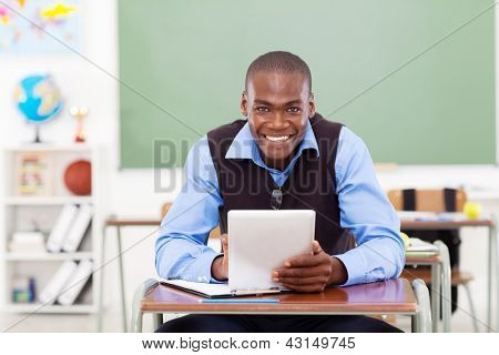 handsome elementary school teacher using a tablet computer
