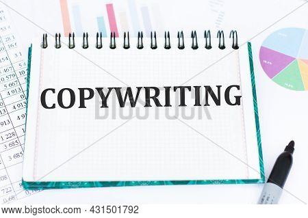 Copywriting Word On Open Notebook On Office Desk