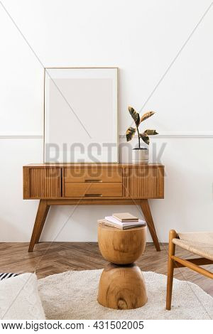 Picture frame on a wooden sideboard table