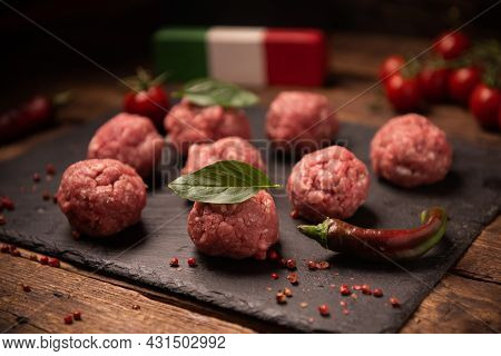 Raw Meatballs On  Dark Basalt Plate