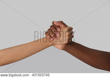 Woman And African American Man Clasping Hands On Light Grey Background, Closeup