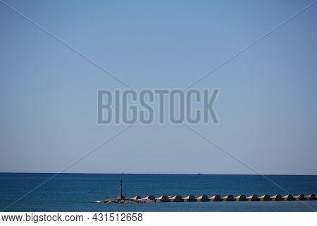 The Storm Surge Barrier Breakwater. Concrete Block Breakwater In Port. Sea Landscape.