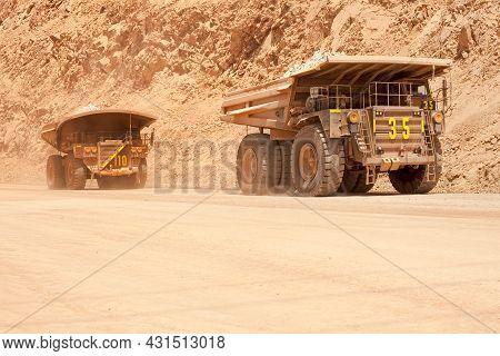 Huge Large Dump Trucks At An Open-pit Copper Mine In Peru.
