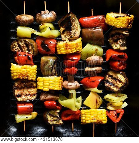 Vegetable Skewer On A Skewer In A Grill Pan On Black Concrete Background. Vegetables To Grill In A P