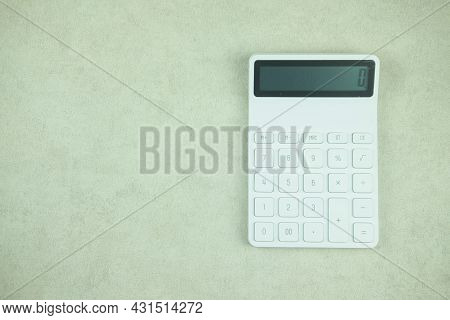 Close Up Shot Of The White Calculator, Top View