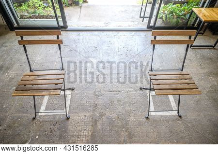 An Empty Chairs Without Nobody Sitting On It, Keep Spaced Between Each Chairs Make Separate For Soci