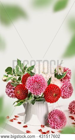 Bouquet Of Autumn Dahlias Flowers On White Table, Isometric View. Vertical Smartpone Stories Format
