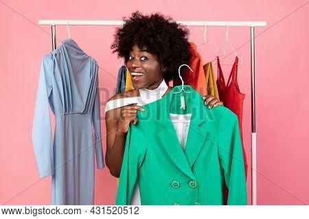 Joyful African American Shopaholic Woman Shopping Holding Jacket, Pink Background