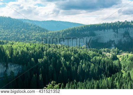 Wooded Hilly Landscape With Rocks That Resemble Waves
